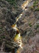 Yellow river below the prison and mine   Një lum i bardhë poshtë minierës dhe burgut