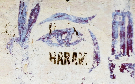 An unknown person has placed the Arabic word 'haram' (sinful) over the logo of the Sigurimi, communist Albania's feared state security police.