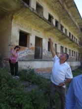 Mr. Zenel Drangu, former political prisoner in Spaç, showing where the flag was raised during the May 1973 revolt | Zoti Zenel Drangu, ish i burgosur politik në Spaç, tregon vendin ku u ngrit flamuri gjatë revoltës së Majit 1973