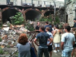 Visitors tour ruins near death row. Photo courtesy of Materials Conservation Co., LLC