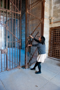 "In ""Hands on History"" visitors get the chance to interact with Eastern State Penitentiary in fun ways, like learning to open the large front gates.  Photo courtesy of  easternstate.org"
